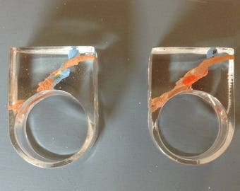 Resin ring with swimming lady. (R)
