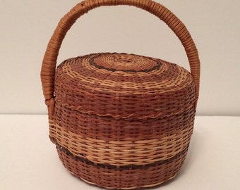 small woven lidded basket / sewing basket