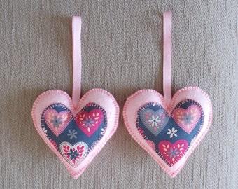 Handmade pair of pink felt love heart hanging decorations