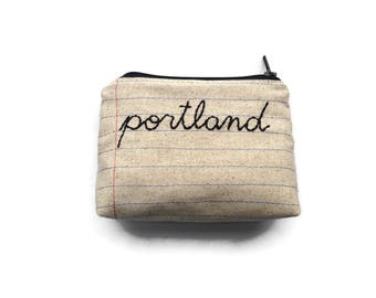 Zipper pouches and party supplies handmade with by montclairmade portland handmade city souvenir notebook paper fabric hand embroidered cursive letters portland negle Images