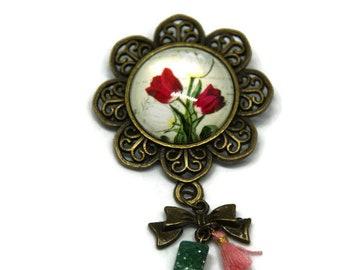 Floral brooch, Pearl and coral tassel