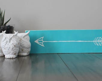 Teal rustic arrow sign