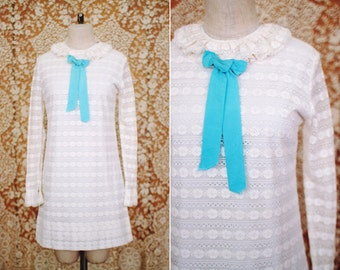 vintage 1960's white lace mini dress with blue bow / size s