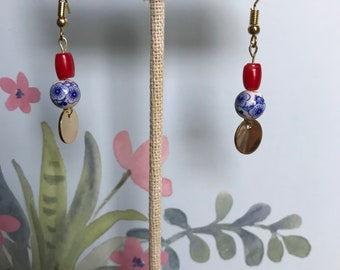 Handmade red and white bead earrings with gold drops
