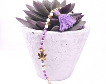 Bracelet glass beads, lilac tassel and lotus flower
