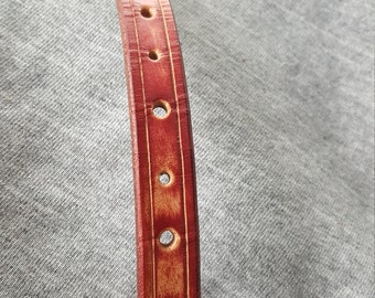 "This is a burgundy bracelet and fits a 6 1/2"" wrist."