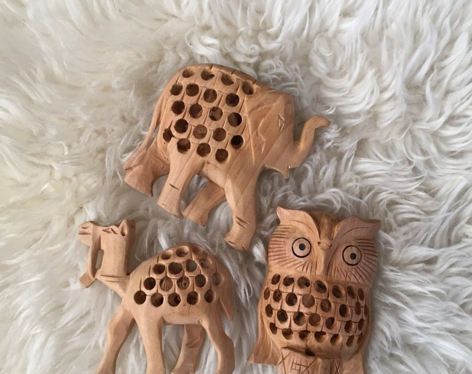 wood carved animal figurine / owl elephant camel / with baby inside