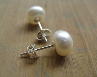 white pearl earrings in sterling silver. pearl stud earrings. silver earrings.