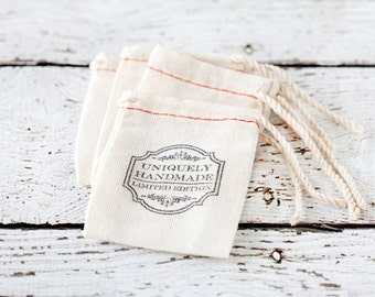 Hand stamped muslin bags, cloth bags, favor bags, drawstring gift bags, packaging, uniquely handmade, limited edition, vintage, gift bags