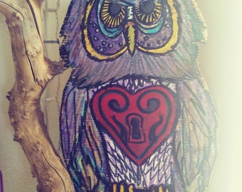 multi-colored owl on a branch
