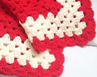 Chunky red and cream crochet blanket