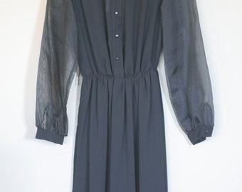 vintage long sleeved black sheer dress by shapely dress co