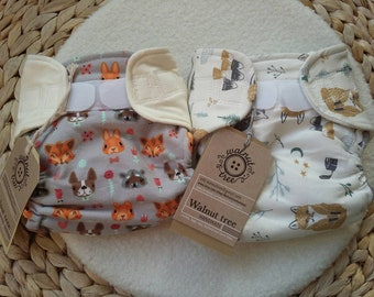 Newborn fitted diaper, velcro