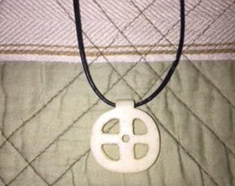 Bone solar cross pendant