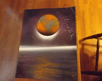 orange planets in a purple sky spray paint art