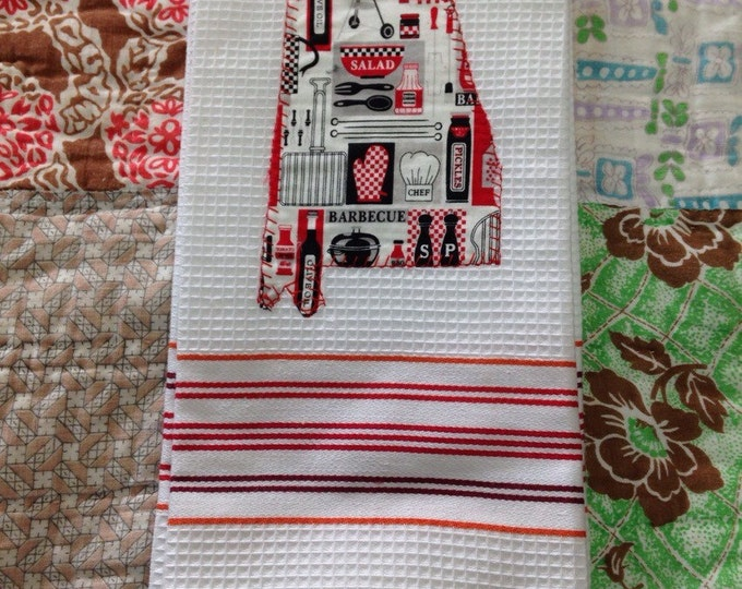 Tea towel with State of Alabama BBQ fabric sewn on the front.