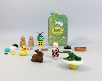 Tiny toys in a tin for imagination play. New toys & vintage random stuff that kids love. Personalize it with child's name.