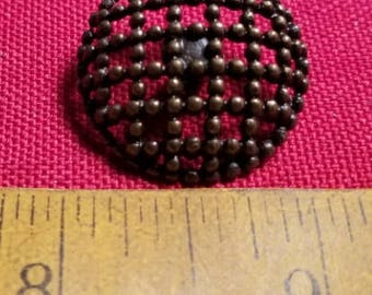 Single large metal coat button
