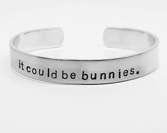 it could be bunnies:BTVS fandom hand stamped aluminum Buffy the Vampire Slayer Once More With Feeling cuff bracelet