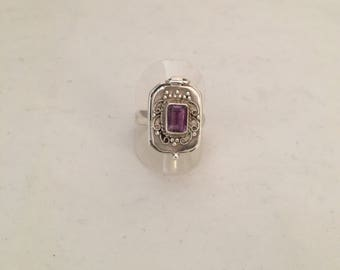 Topped with a stone Amethyst poison ring