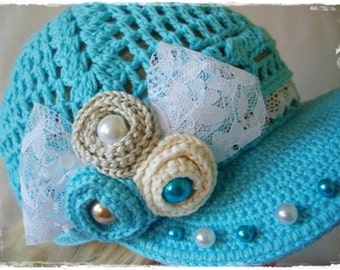Blue crochet hat with flower and beads