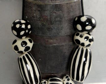 handmade ceramic beads necklace. unique black decoration on earthenware piece chic jewelry-white