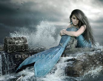 fantasy mermaid with blkue tail sits on ocean rocks art print