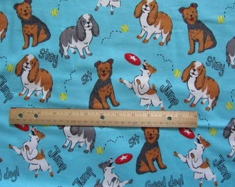 Blue With Multicolored Dogs and Words Flannel Fabric by the Yard