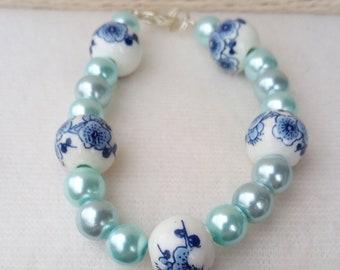 Bracelet glass pearl beads and blue porcelain flower beads