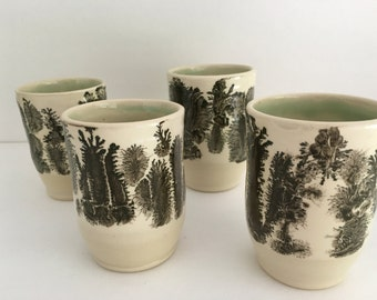 Four handmade ceramic tumblers. Mocha Diffusion dendritic branches decor by Ruth Sachs