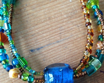 Triple strand glass and metal beaded necklace