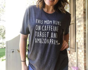 This mom runs on caffeine, target, and amazon prime. Target. Amazon prime. Coffee. Mom life. Mom shirts. Mom tshirt. Mom style.