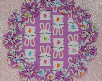 Bunnies with Easter Eggs on Lavender Yo Yo Doily
