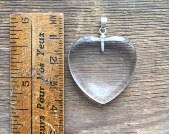 Natural quartz heart pendant with sterling silver bale