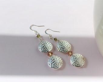 Swarovski crystal earrings. Dangle and drop earrings. Green. Silver earrings.