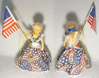 Ms. America, musical doll, plays God Bless America as she turns