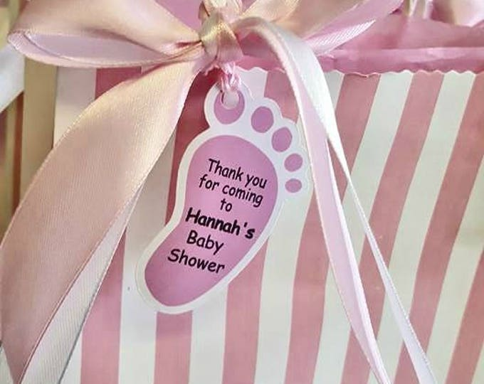 Baby shower filled favour bag with personalised candle and sweets
