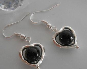 Black beaded heart earrings