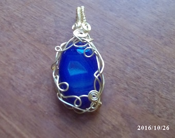 Purple and silver plated wire wrapped pendant