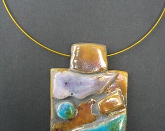 A colorful originalen raku pendant, mounted on a matching steel cable