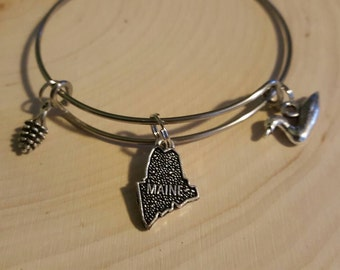 Maine themed bangle bracelet with Loon and pine cone charm