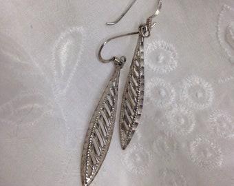 Sterling diamond cut dangle earrings