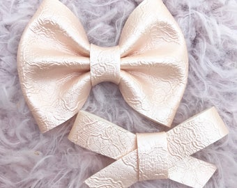 Peach pearl lace vegan leather brooke or madison bow