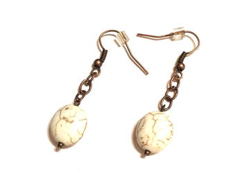 Earrings. White howlite beads on copper colored ear wires and chain.
