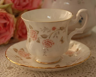 Royal Albert Un-named Teacup and Saucer Demitasse Teacup Saucer orange / soft peach colored flowers and butterflies on white porcelain