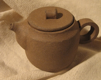 Unglazed Stoneware Teapot and Cup