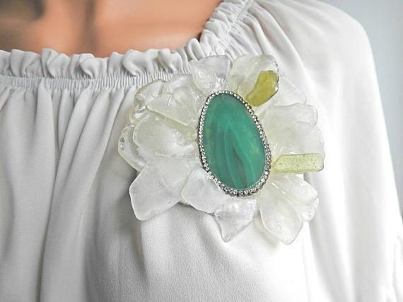 green brooch