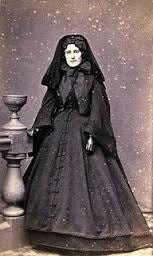 A woman in full mourning attire in the 19th century.