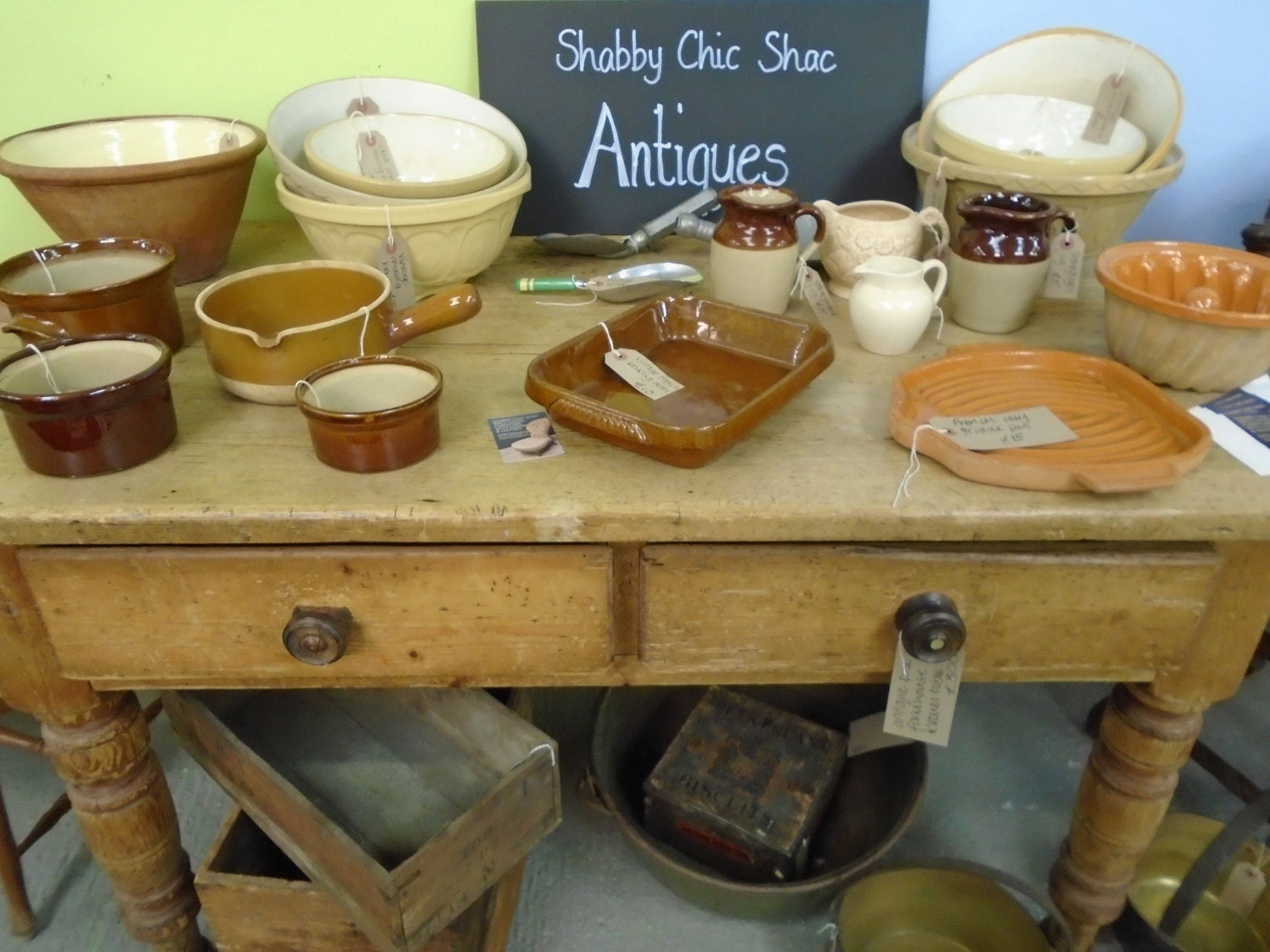 Farmhouse kitchen table laden with French vintage stoneware