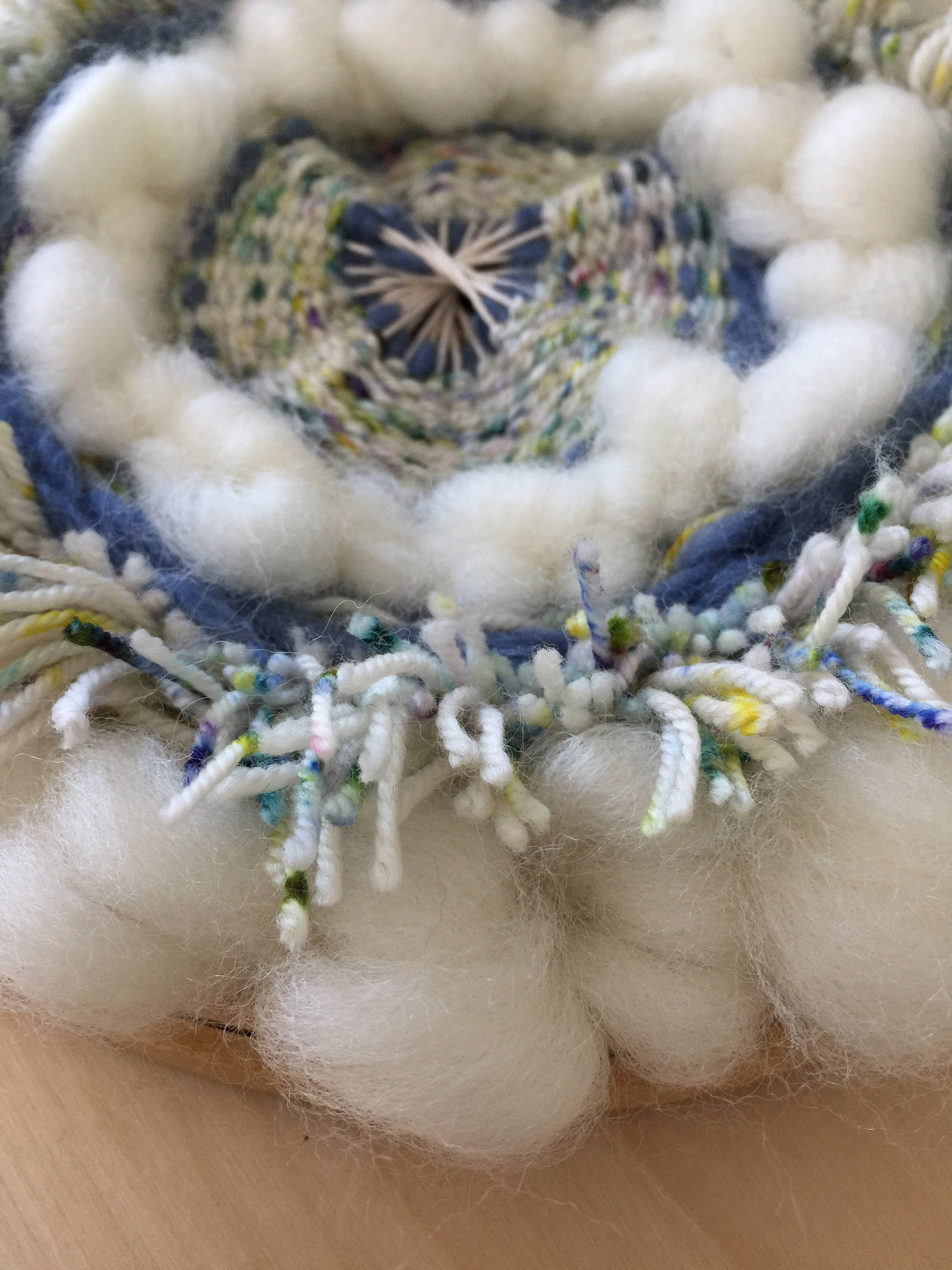 Circular Wall Hanging made with wool roving and indie dyed wool.